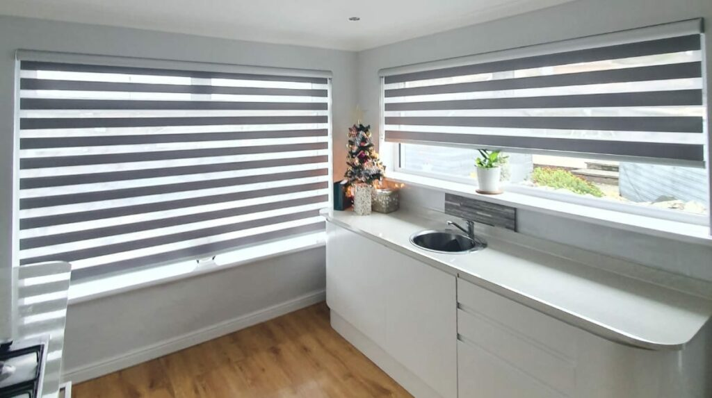 day and night blinds with grey lines in a bathroom