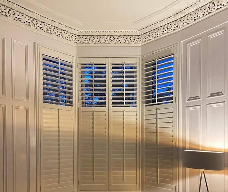 made-to-measure-shutters-bay-window-light-night